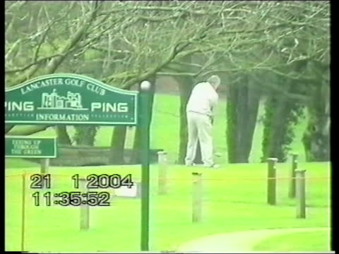 lancaster ext poor quality pix henry calvert along in to court building obscured by large golf umbrella bv calvert up stairs ends lancaster golf club... - golf bag stock videos and b-roll footage