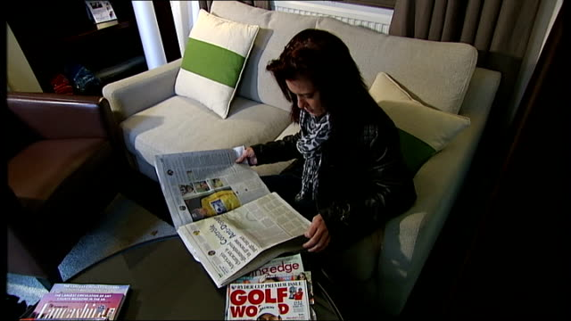 Lance Armstrong doping allegations ENGLAND INT Emma O'Reilly setup reading newspaper report about Lance Armstrong doping allegations Framed 199 Tour...