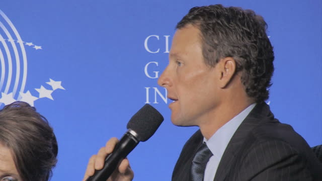 lance armstrong talking on microphone during annual clinton global initiative / new york city new york usa / audio - ランス・アームストロング点の映像素材/bロール