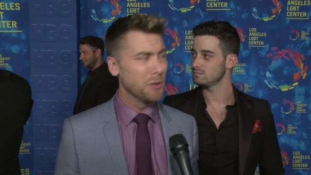 stockvideo's en b-roll-footage met interview lance bass and michael turchin on why the los angeles lgbt center and their services are so vital to the community on if they have had a... - anniversary gala vanguard awards