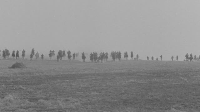 WS Lancers charging into valley on horseback / Unspecified
