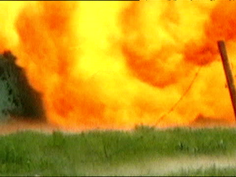 land mine explodes in controlled explosion during iraq war 29 mar 03 - land mine stock videos and b-roll footage