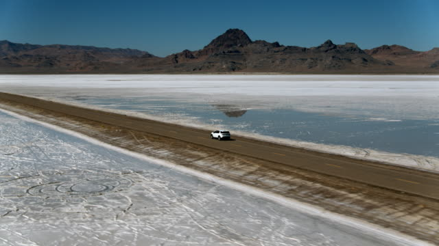 land rover driving along the utah salt flats - west wendover stock videos and b-roll footage