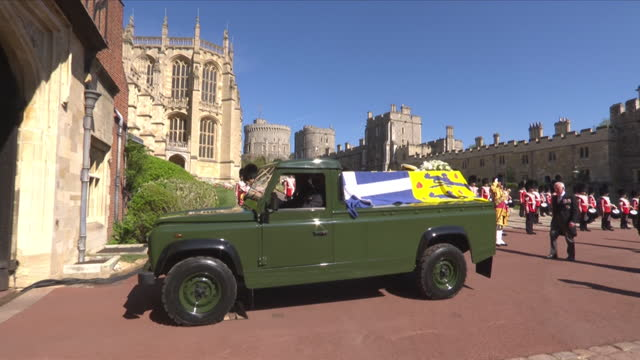 """land rover hearse, carrying coffin of prince philip duke of edinburgh, driven through grounds of windsor castle, for funeral - """"bbc news"""" stock videos & royalty-free footage"""