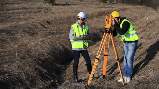 Land surveyors on construction site