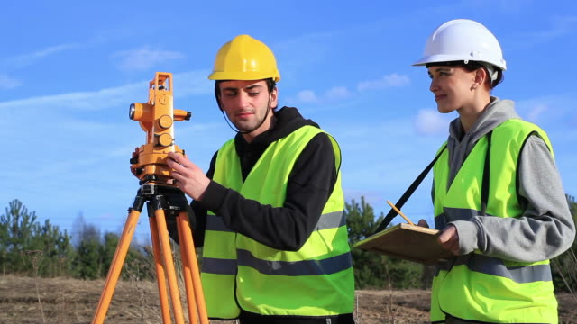 land surveyors on construction site - surveyor stock videos and b-roll footage