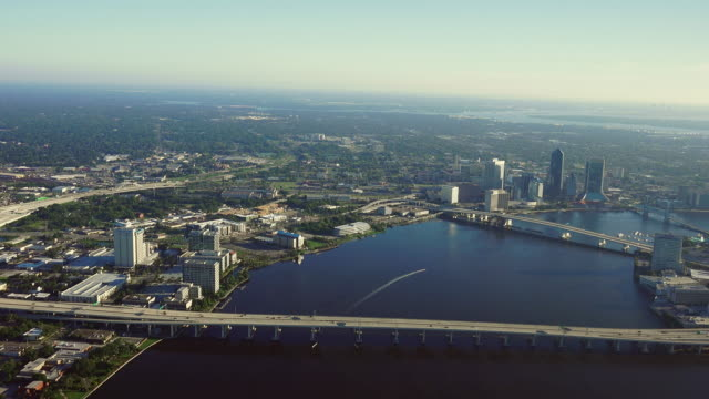 ws aerial pov land vehicles moving on 95 bridge, downtown in background / jacksonville, florida, united states - jacksonville florida stock videos and b-roll footage