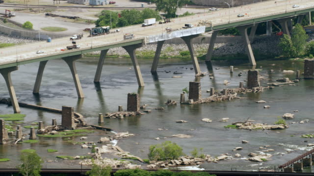 WS AERIAL POV Land vehicles moving on bridge with James River / Richmond, Virginia, United States
