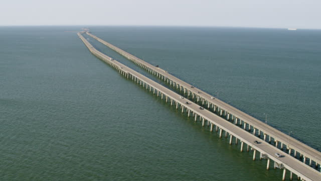 ws aerial pov land vehicles moving on chesapeake bay bridge / virginia beach, virginia, united states - virginia beach stock videos & royalty-free footage