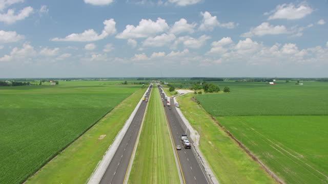 WS TU AERIAL POV Land vehicles moving on Interstate 69 / Huntington County, Indiana, United States