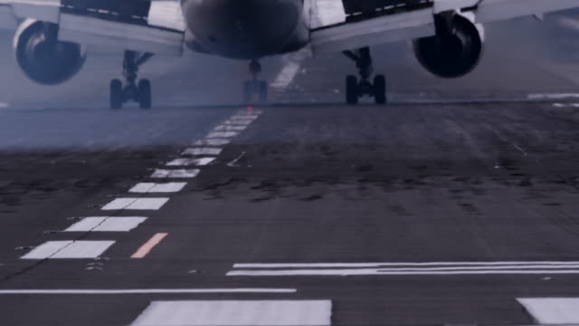 landed airplane on airplane runway - landen stock-videos und b-roll-filmmaterial