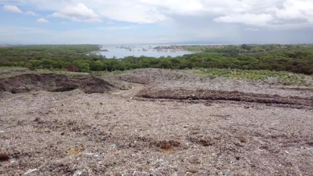 landfill suwung - trash hill serangang bali - indonesia stock videos & royalty-free footage