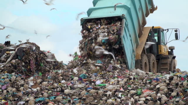 landfill with garbage trucks unloading junk - plastic stock videos & royalty-free footage