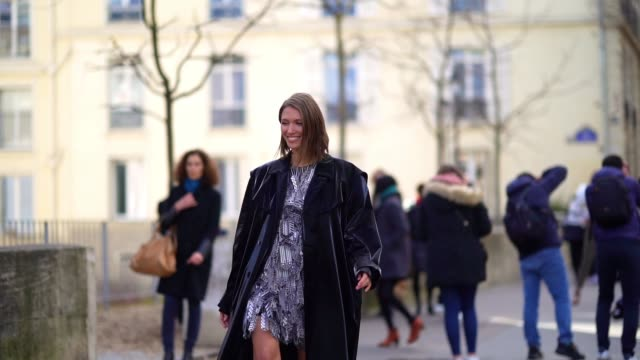 landiana cerciu wears a black and white rahul mishra dress with a feather-design and geometric patterns, during paris fashion week - womenswear... - pattern stock videos & royalty-free footage