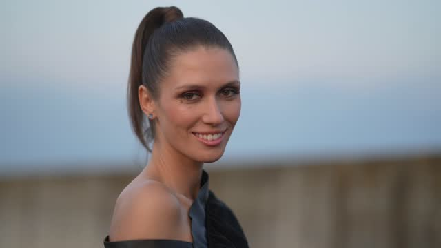 landiana cerciu wears a black one-shoulder knee-length dress with integrated belt and a leather sleeve, black leather boots, outside the a-list show,... - ponytail stock videos & royalty-free footage