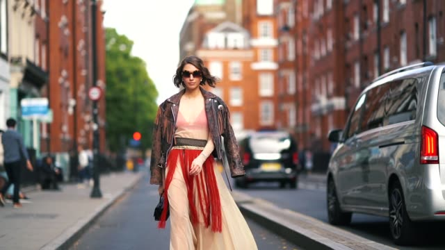 landiana cerciu wears a brown leather jacket with fringes a lace skirt a black bag sunglasses during london fashion week september 2018 on september... - bangs stock videos and b-roll footage