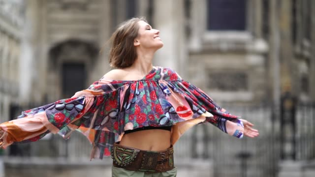 landiana cerciu wears a multicolor offshoulder bare belly cropped pleated top a red bag green pants during london fashion week september 2018 on... - multi coloured stock videos & royalty-free footage
