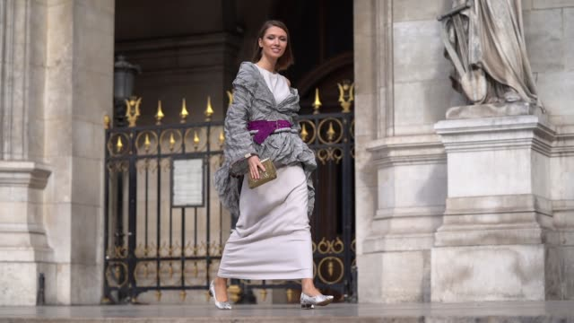 landiana cerciu wears a white long dress a long sleeves offtheshoulder grey embossed fabric jacket with a tail a glittering purple belt grey python... - grey jacket stock videos and b-roll footage