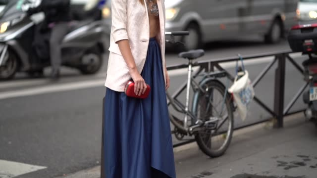 Landiana wears a white blazer a mesh top blue skirt outside Stella Mccartney during Paris Fashion Week Womenswear Spring/Summer 2018 on October 2...