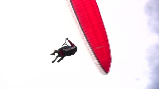 landing a paraglider - tandem stock videos & royalty-free footage