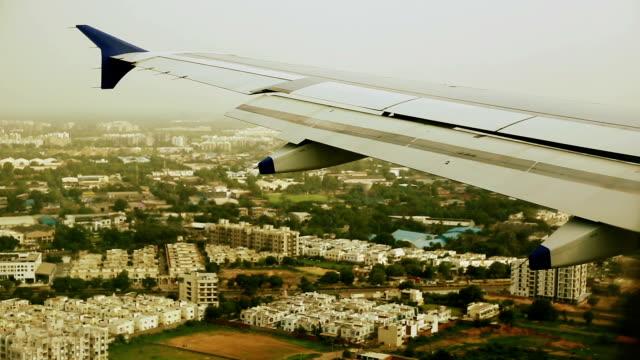 Landing aircraft and Ahmedabad City, India