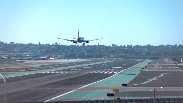 landing airplane in slow motion - landing touching down stock videos & royalty-free footage