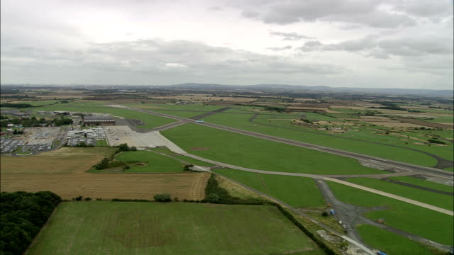landing at durham tees valley airport  - aerial view - england, darlington, united kingdom - darlington north east england stock videos & royalty-free footage