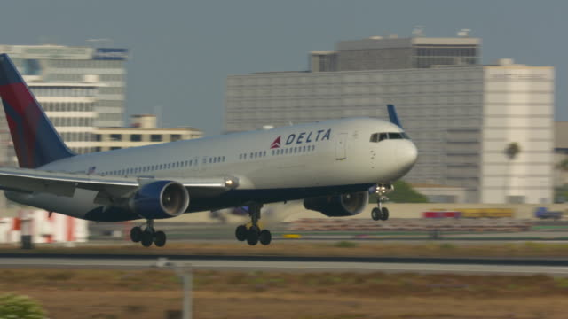landing at lax - delta stock videos and b-roll footage