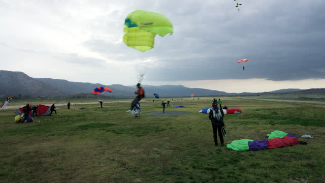 landing at the end of the day - parachute formation skydivers - 50 59 years stock videos & royalty-free footage