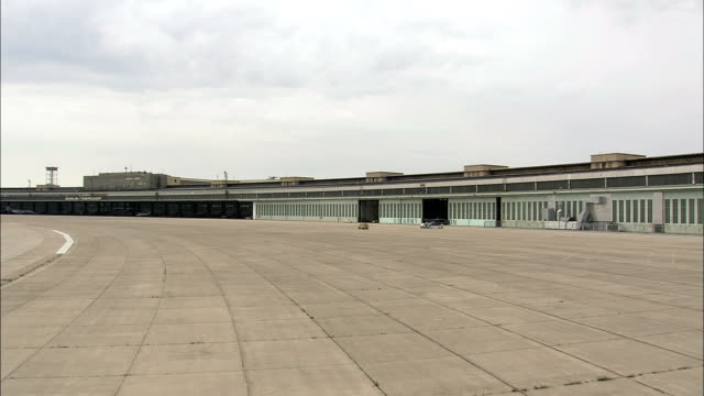 landing at the old tempelhof airport  - aerial view - berlin,  berlin,  stadt,  germany - cold war stock videos & royalty-free footage