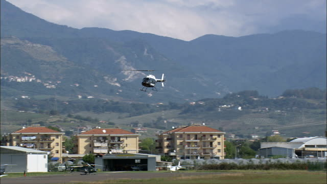 landing at the salerno costa d'amalfi airport  - aerial view - campania, provincia di salerno, pontecagnano faiano, italy - helicopter landing stock videos & royalty-free footage