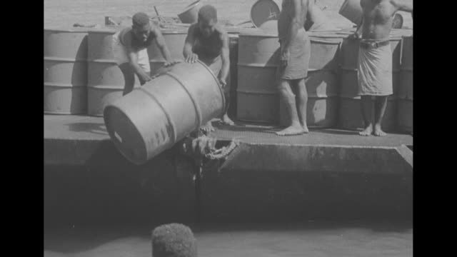 vs landing barges carry soldiers supplies barrels as us army arrives at guadalcanal to replace marines / landing barge full of barrels / vs islanders... - unloading stock videos & royalty-free footage