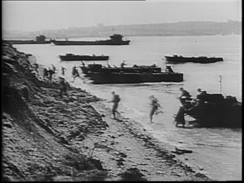 landing barges coming into shore at normandy / plane flying over barges laying smokescreen / barges making landfall as artillery explodes overhead /... - landing craft stock videos & royalty-free footage