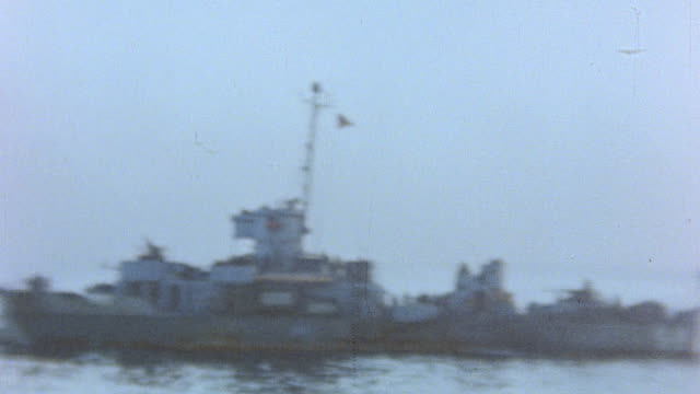 landing craft heading for the shore task force 52 firing in support landing craft firing and smoke rising from mount suribachi / iwo jima japan - schlacht um iwojima stock-videos und b-roll-filmmaterial
