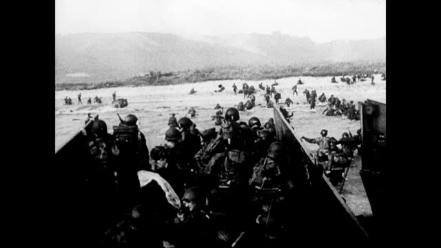 / landing craft hits shore and soldiers pile out / from soldiers view of beach / hundreds of soldiers wading through the water. d-day beach landings... - d day stock videos & royalty-free footage