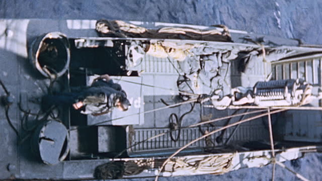 landing craft hoisted by crane from alongside and lowered to deck of uss hansford during world war ii pacific campaign - pacific war stock videos and b-roll footage