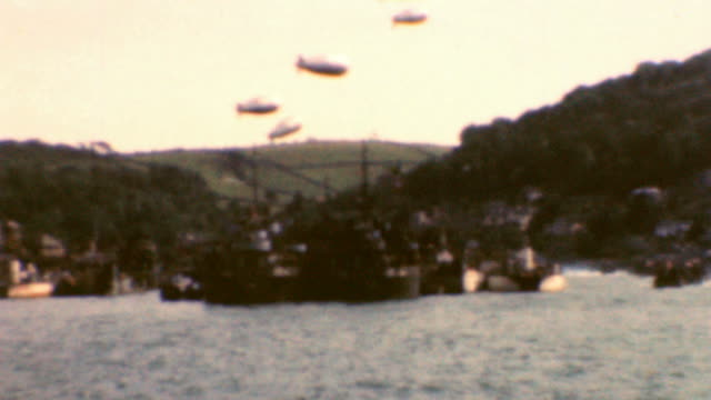 landing craft mechanized take to the channel / lst ships with blimp cover / operation overlord wwii on june 05, 1944 in dartmouth, devon - d day stock videos & royalty-free footage