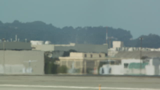landing gear of china airlines cargo 747 touching down at san francisco international airport - タッチダウン点の映像素材/bロール