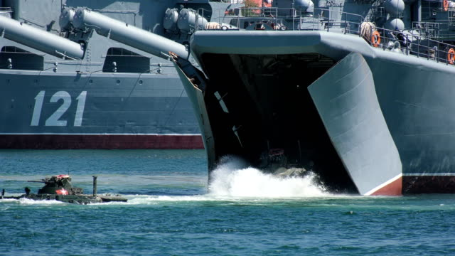 landing of amphibious armored personnel carriers from ships at sea under the cover of warships - amphibious vehicle stock videos & royalty-free footage