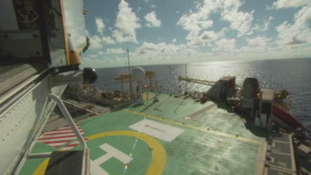 Landing on the helipad of an oil production platform, Australia