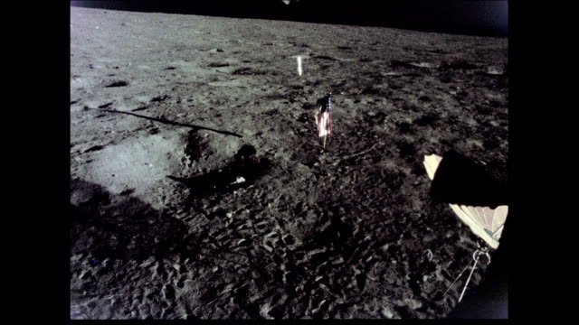 / landing site located in the southeastern portion of the ocean of storms / deflated american flag on moon surface. apollo 12 lunar landing site on... - 1969 stock videos & royalty-free footage