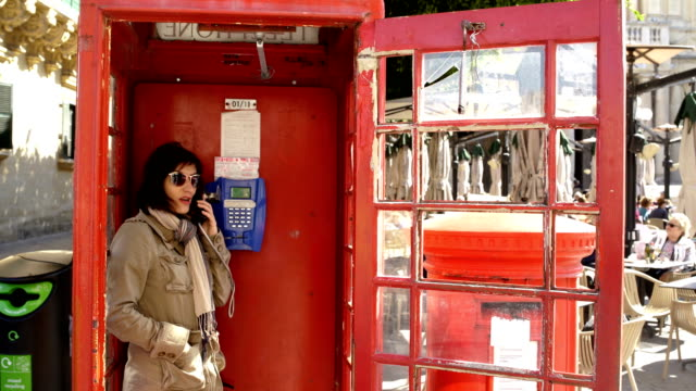 landline phone is still in use,charming red telephone booth - telephone booth stock videos & royalty-free footage