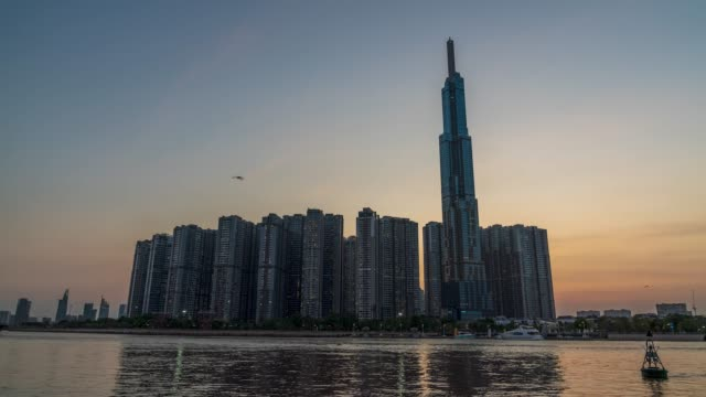 landmark 81 illuminates the heart-shaped symbol to spread the message of love and prevention of the covid-19 pandemic - ho chi minh city, vietnam. - anniversary stock videos & royalty-free footage