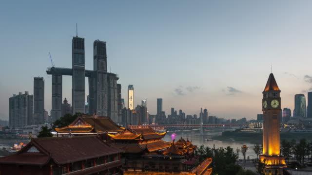 landmark building at busy pier, dusk to night transition - raffles city stock videos & royalty-free footage