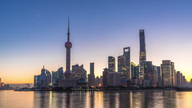 landmark dongfang mingzhu tower and modern buildings in shanghai at sunrise. timelapse hyperlapse - shanghai stock videos & royalty-free footage