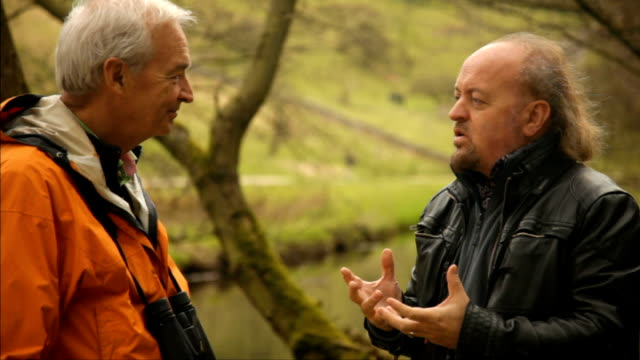 vidéos et rushes de landmark report warns of threats to britain's countryside england derbyshire peak district dovedail ext gvs river flowing comedian bill bailey and... - water bird