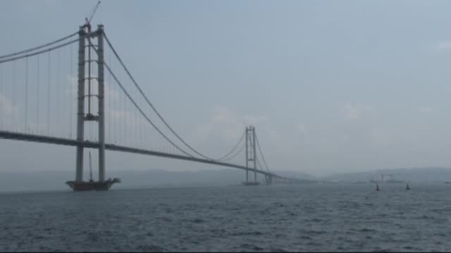 a landmark road bridge over the marmara sea will open to traffic in turkey on thursday which aims to drastically cut travel time between istanbul and... - marmara stock videos and b-roll footage