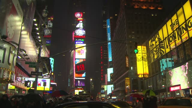 landmarks across the globe including times square in nyc went dark for 1 hour on march 29 2014 to observe earth hour at times square on march 29 2014... - earth hour stock videos & royalty-free footage