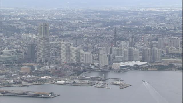 landmarks like the minato mirai 21 and yamashita park line the port of yokohama in kanagawa, japan. - yokohama stock videos and b-roll footage