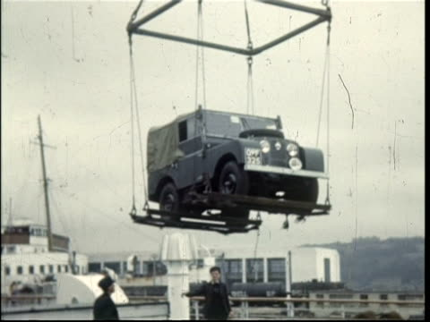 vidéos et rushes de 1950 landrover and car being loaded into ferry, called the gratis, at dover, uk - ferry
